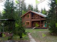 Дома из оцилиндрованного бревна — дизайн деревянного дома и технология строительства (65 фото)